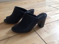 Next black mules..new condition..