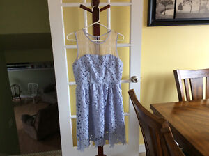 2 dresses, $10 each new condition