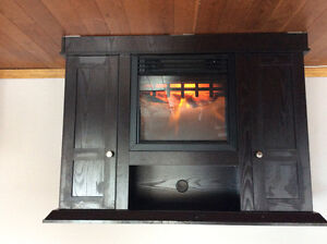 Dark wood fireplace