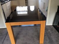 Black Glass top Dining Table.