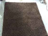 Dark brown pile rug