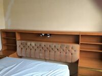 Integral headboard and bedside cabinets.