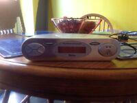 Radio, fits under kitchen units, saves work top space.
