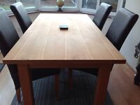 Oak furniture land table and four brown leather and oak chairs