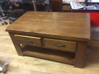 Two sided drawer coffee table