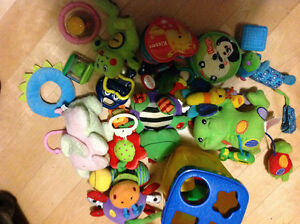 Grocery bag full of infant toys safe for 0-9 months like new