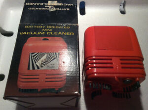 BATTERY OPERATED MINI VACUUM CLEANER - NOT USED