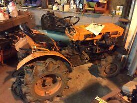 Kubota compact 4x4 tractor with rotavator