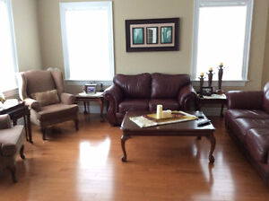 2 leather sofas & 2 matching armchairs incl. tables Price $2800.