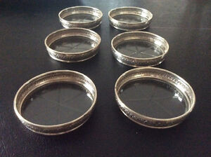 Birks Vintage Sterling Coasters with cut glass bottom.