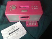 "Pink ""RED iPod dock"" clock radio"