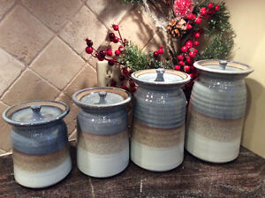 Beautiful pottery Canister set of 4  Was a wedding gift.