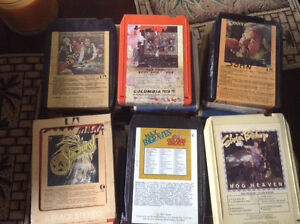 31 old country and rock 8 track tapes,