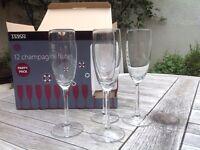 Twelve glass champagne flutes