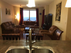 Fabulous 2 bedroom condo large den great place call 7803706532