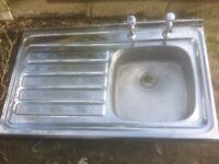 Stainless steel kitchen sink basin with drainer and taps