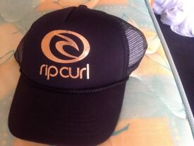 Genuine brand new with tags Rip Curl cap in black and gold