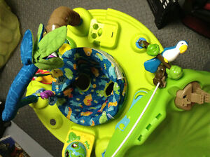 Like New Evenflo Deluxe Exersaucer Triple Fun - Amazon Theme