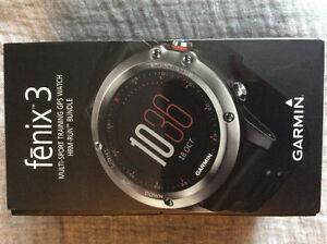 Garmin Fenix 3 GPS Watch with heart rate monitor strap.