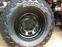265/75R16 Hankook tire on a 8 hole Ford rim, near new.