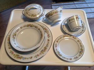 8 place setting of dishes