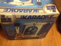 The singing machine karaoke CDs smg-2002 with mic boxed