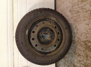 Winter snow tires on rims studded set of 4  14 inch
