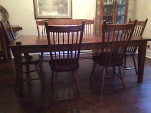 Solid Maple dining table with 2 leaves, 6 chairs and one double