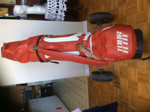 Red leather spalding golf bag, clubs, cart $150. 613-902-7377