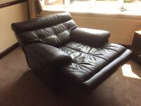LEATHER QUALITY RECLINING ARMCHAIR, BROWN, COST £1000.