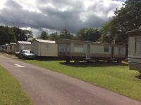 Low cost accommodation in a fully equipped caravan on a caravan park Forres/ Nairn area