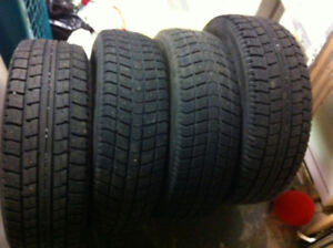 4 Winter tires with rims  185/70 R14