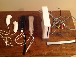 Sweet Deal! Full Nintendo wii system, multi accessories/25games