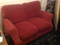 Red two seater sofa good condition