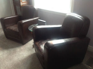 2 Brown Leather Chairs and Ottoman