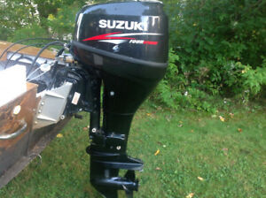 25hp Suzuki fourstroke outboard motor with controls