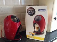 Red Delonghi Dolce Gusto with pods