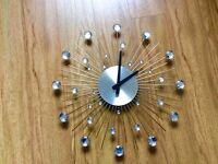 Silver star burst clock