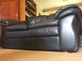 Navy leather 2 seater sofa.