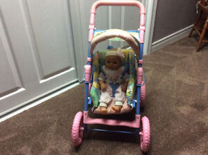 DOLLSTROLLER WITH DOLL