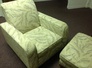 Arm chair with footrest