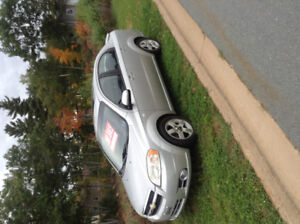 2007 Chevrolet Aveo Sedan LE.  With sunroof