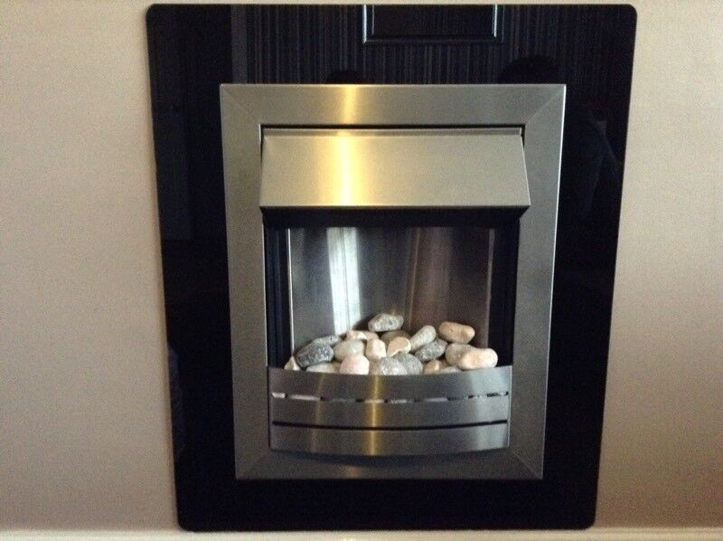 Electric fire and black glass surround.