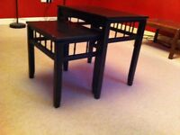 Lovely pair of unusual black wooden nesting tables
