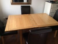 Extending oak table and 4 leather chairs