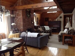 Log Home (Chalet Style) in Crapaud.  (Indoor Pics)