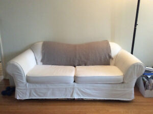 Roll Arm Couch - custom white denim slipcover