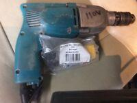 Makita hammer 110 v drill