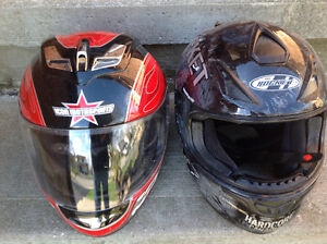A pair of motorcycle helmets ICON and JOE ROCKET