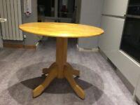 Light wood round table
